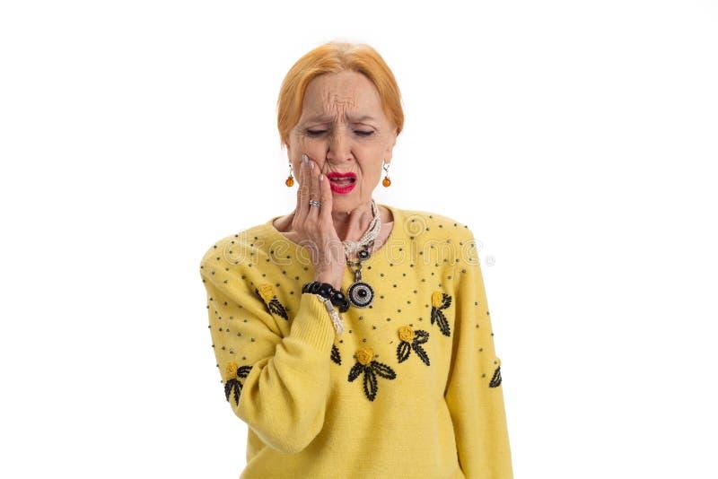 Femme âgée ayant le mal de dents photo libre de droits