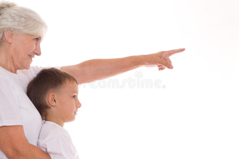 Femme âgée et garçon images stock