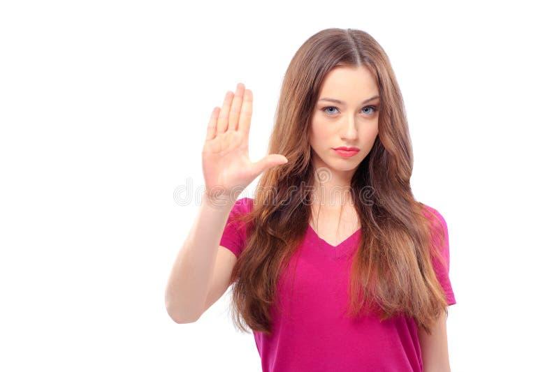 Femme étirant des mains et montrant sa paume photos stock