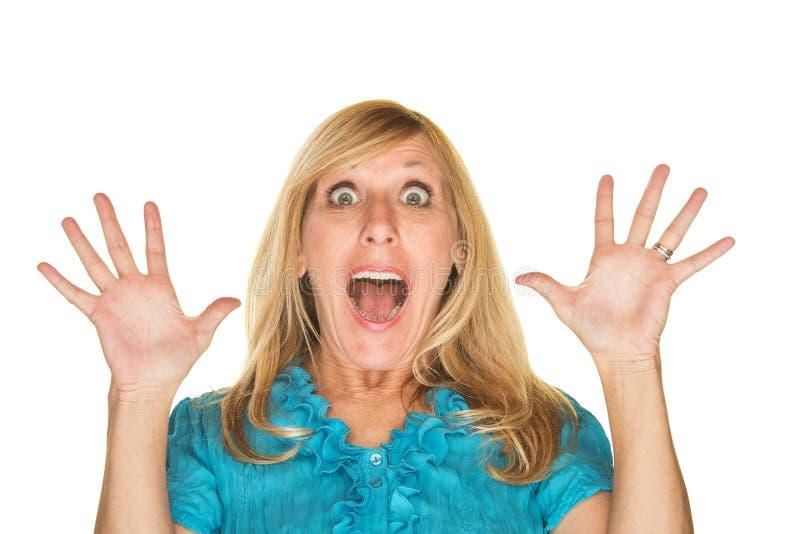 Femme étonné avec des mains vers le haut image libre de droits