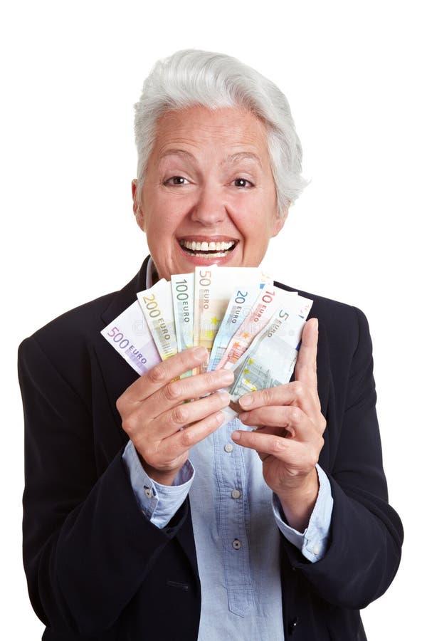 Femme aîné gagnant l'euro argent images libres de droits