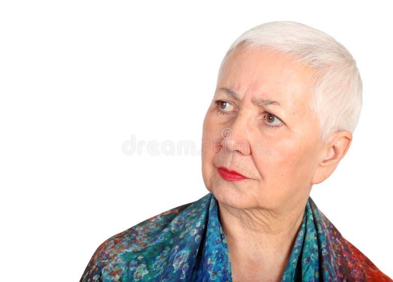 Femme aînée inquiétée photographie stock libre de droits