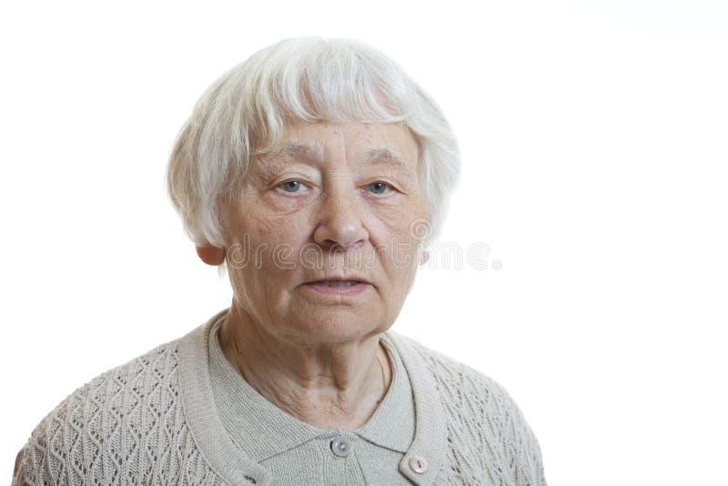 Femme aînée sérieuse photos stock