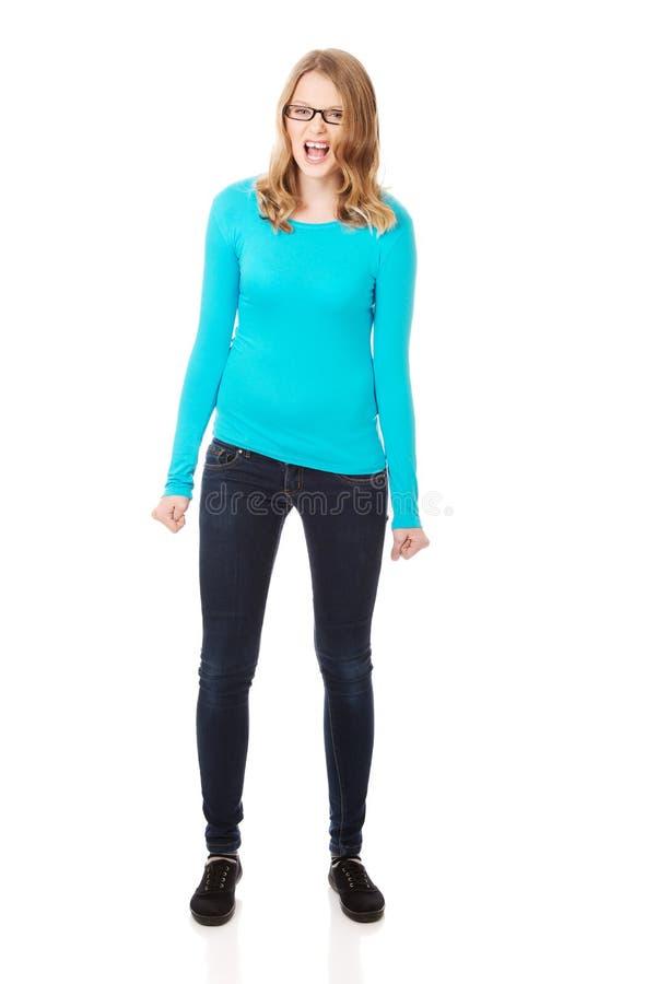 Femme adolescente fâchée faisant des poings photos libres de droits