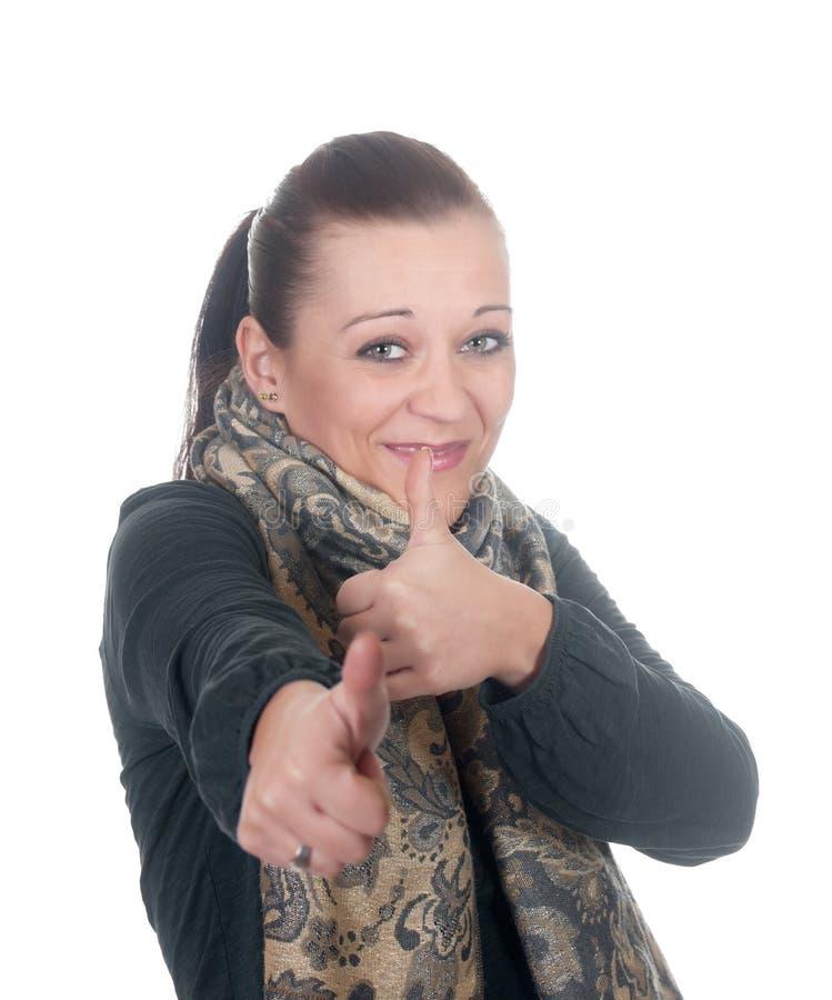Femme affichant des pouces vers le haut image libre de droits