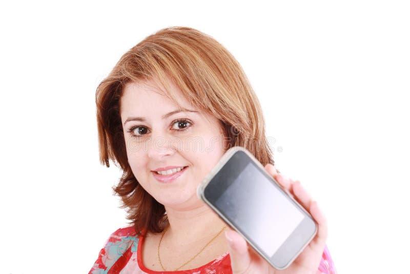 Femme affichant le téléphone portable photographie stock libre de droits
