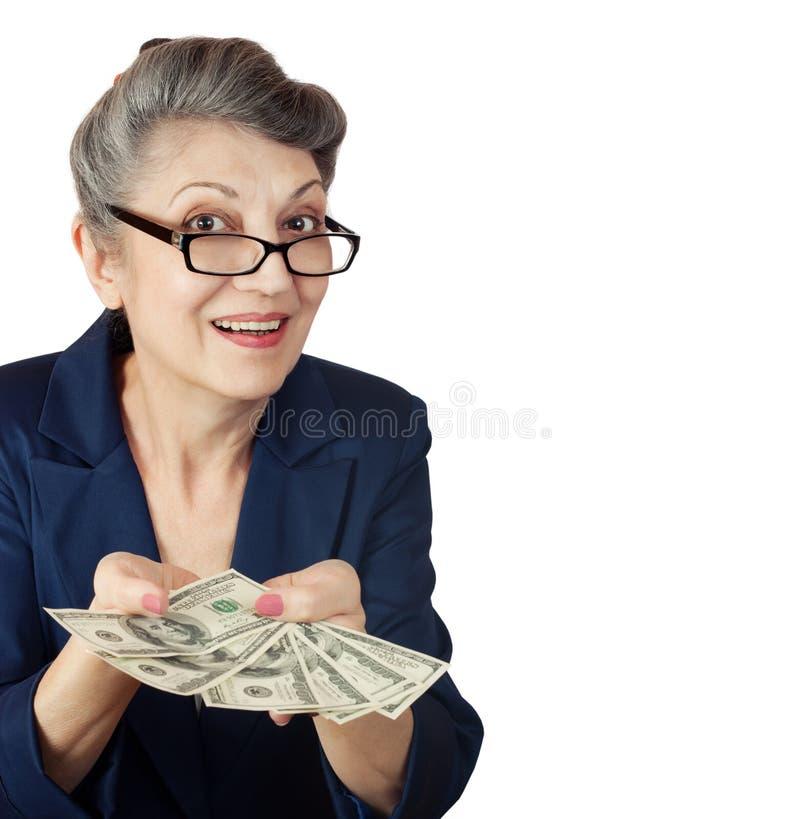 Femme agée avec des dollars photos stock