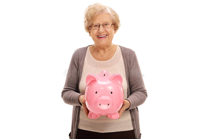 Femme agée heureuse avec une tirelire photographie stock libre de droits