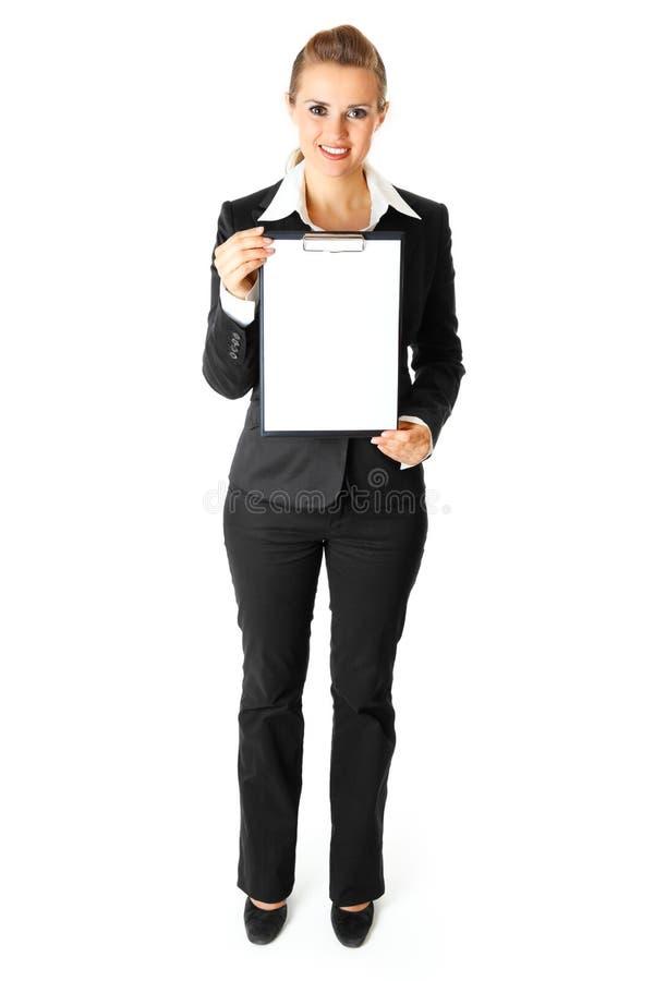 Femme amical d'affaires retenant la planchette blanc images libres de droits