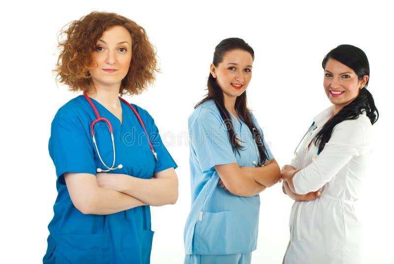 Femme amical de docteur et son équipe photographie stock