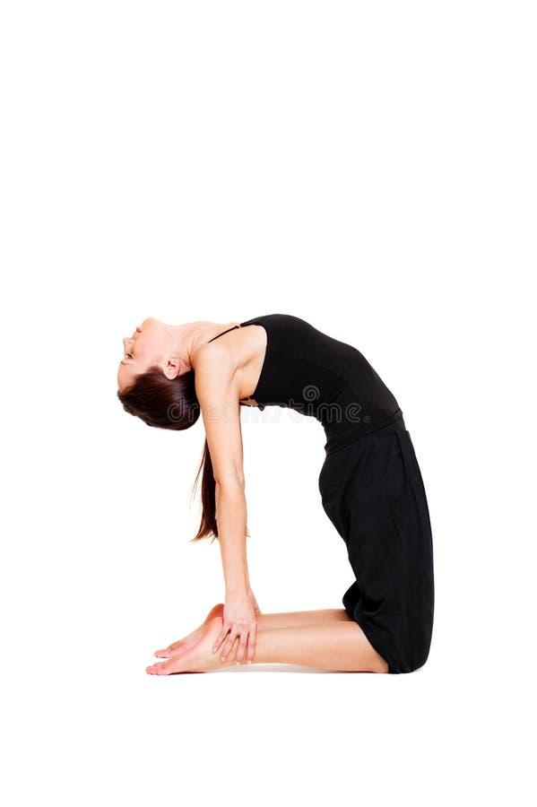Femme animé sportif dans le fléchissement noir de vêtements de sport photographie stock