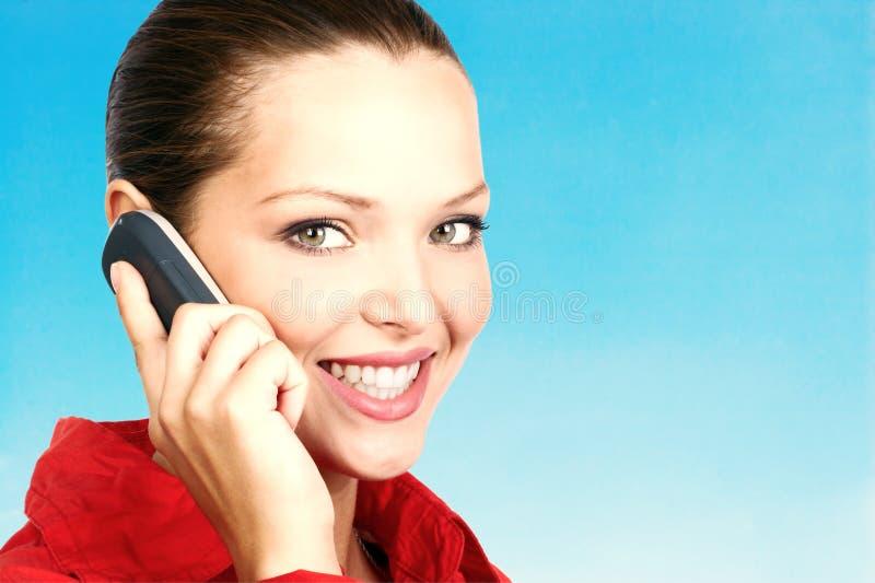 Femme appelant par le téléphone photo libre de droits