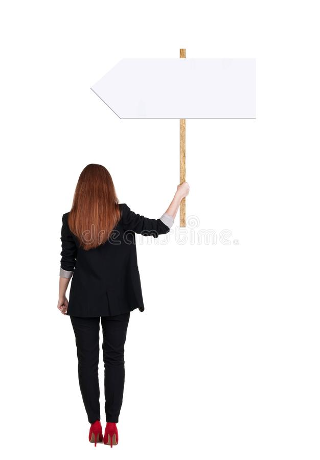 Femme arrière d'affaires de vue montrant le panneau de signe photographie stock libre de droits