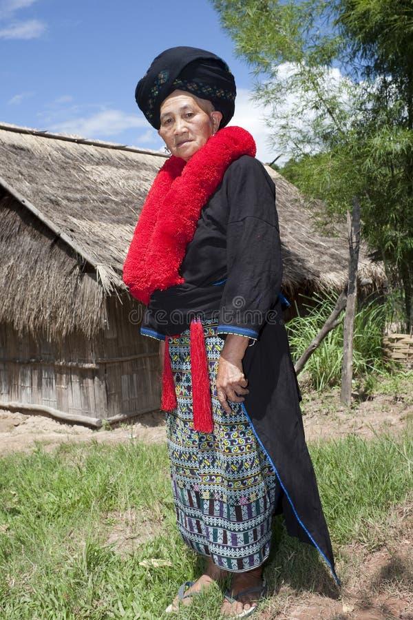 Femme asiatique avec la robe au Laos, Yao photographie stock