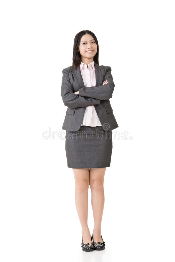 Femme asiatique de sourire d'affaires avec les bras croisés photo stock