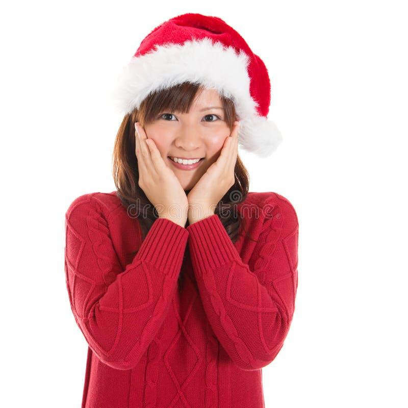 Femme asiatique joyeuse de Noël image stock