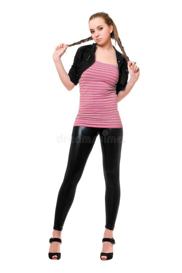 Femme assez jeune espiègle dans des guêtres noires photos stock