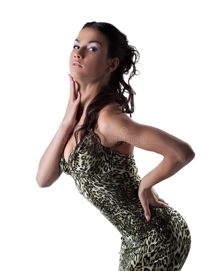 Femme assez sensuelle posant dans la robe de mode photo libre de droits