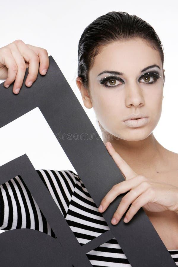 Femme attirant avec la trame de papier photographie stock libre de droits