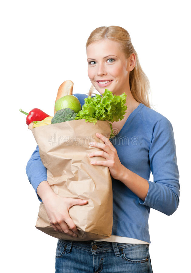 Femme attirant avec un sac plein de la nourriture saine photos stock