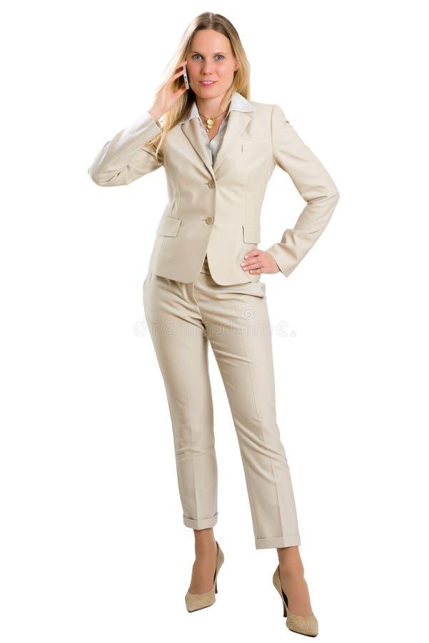 Femme attirante d'affaires un appel téléphonique, d'isolement sur le blanc image libre de droits