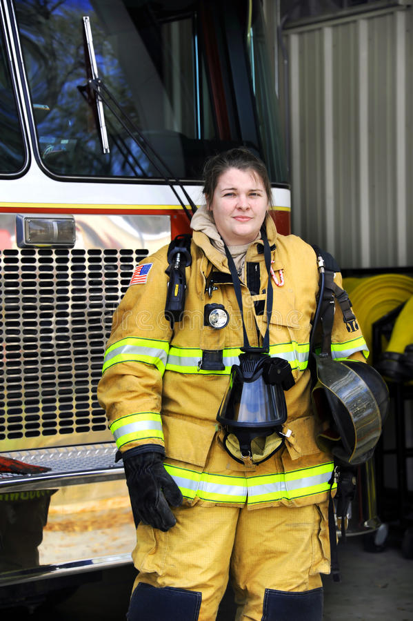 Femme attirante d'incendie photographie stock