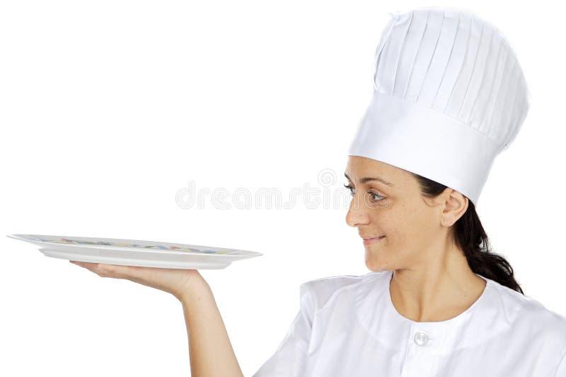 Femme attirante heureuse de cuisinier image stock