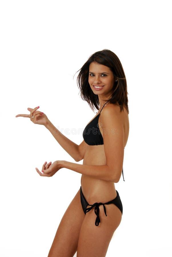 Femme au pointage de bikini image stock