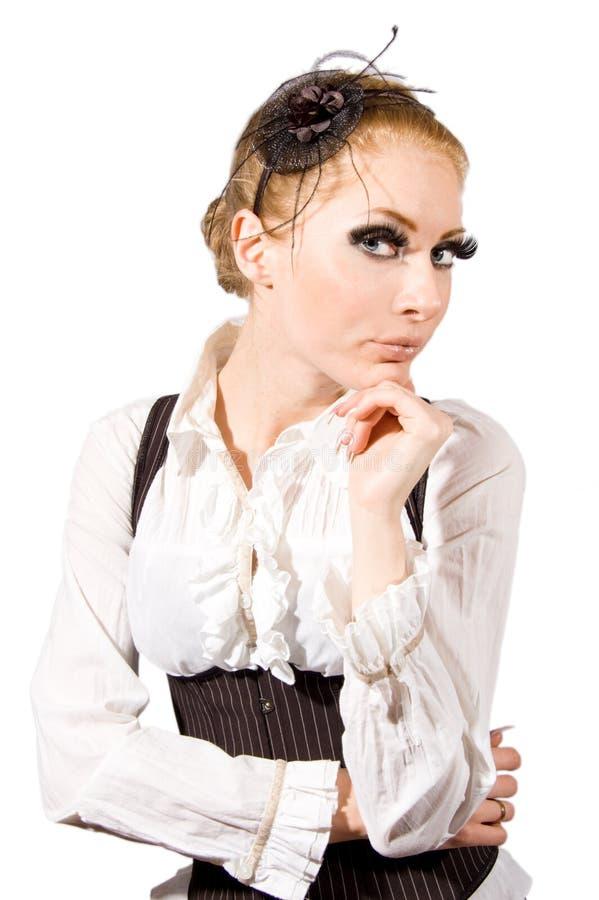 Femme avec de longs jeux et corset photo stock