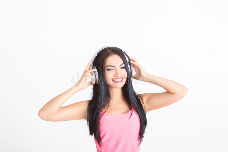 Download Femme avec des écouteurs photo stock. Image du heureux - 76090710