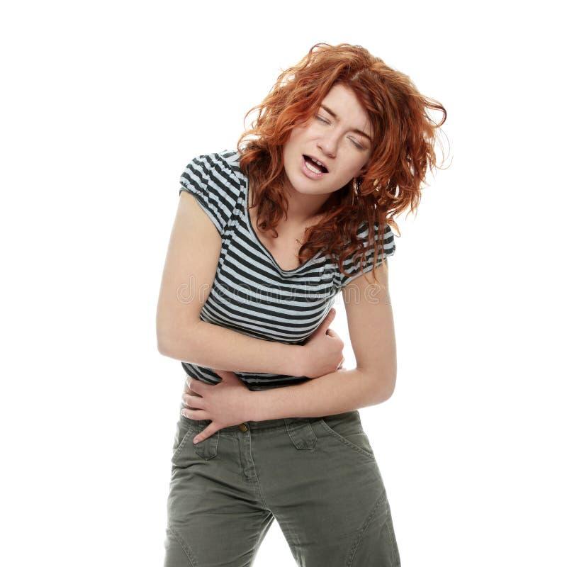 Femme avec des émissions d'estomac photo stock