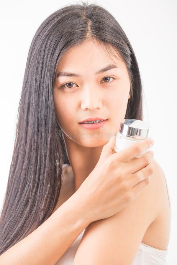 Download Femme avec des cosmétiques photo stock. Image du renivellement - 87705780