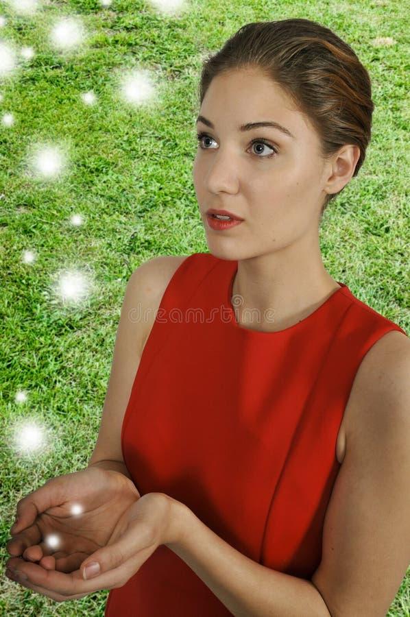 Femme avec des globes photo stock