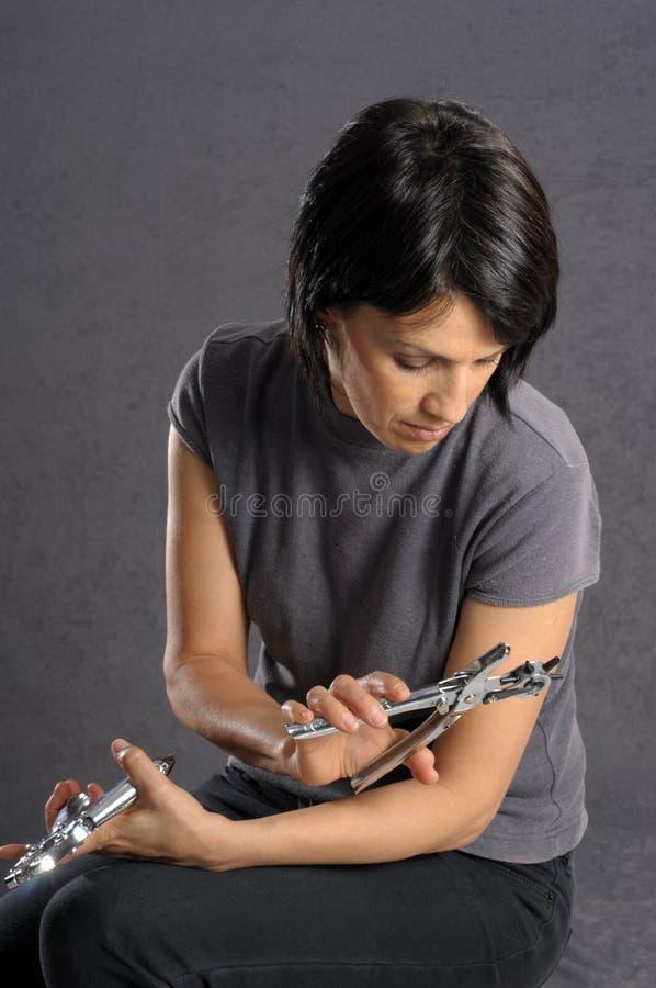 Femme avec des outils photographie stock libre de droits