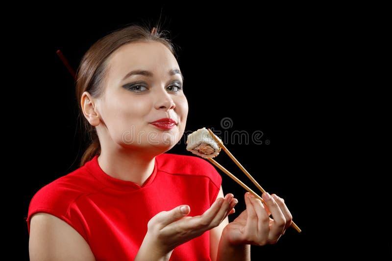 Femme avec des sushi photos libres de droits