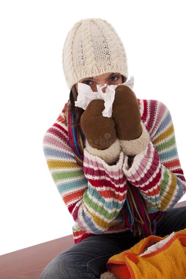 Femme avec des sympt40mes de grippe image libre de droits