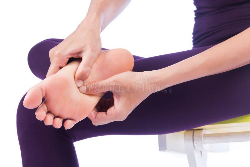 Femme avec douleur de pieds photographie stock libre de droits