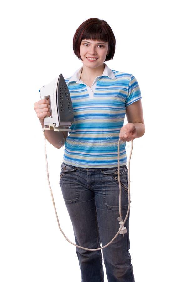 Femme avec du fer électrique photographie stock