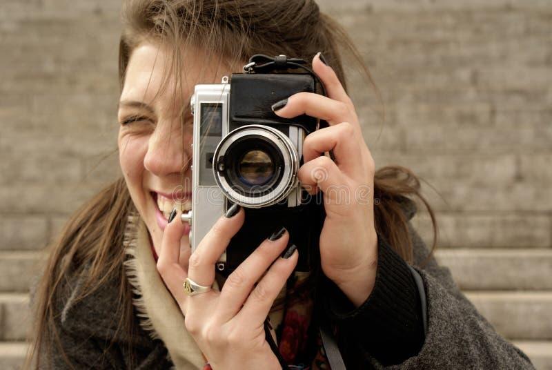 Femme avec l'appareil-photo photo stock