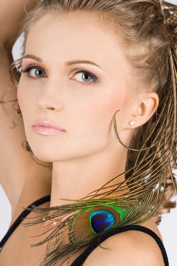 Femme avec l'oeil de clavette de paon images libres de droits