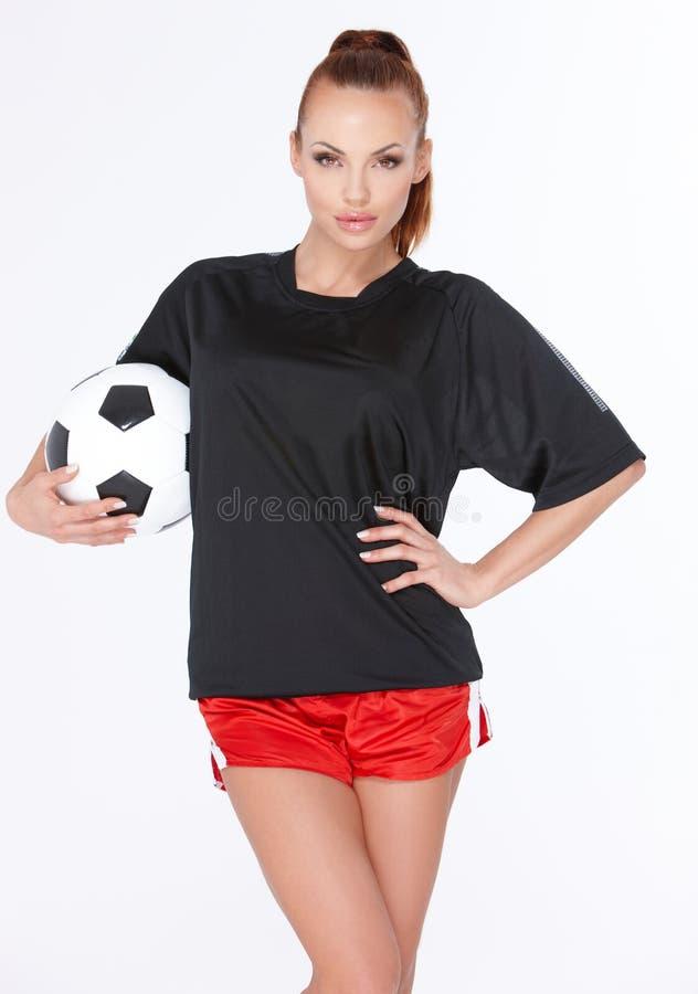 Femme avec la bille de football photos stock