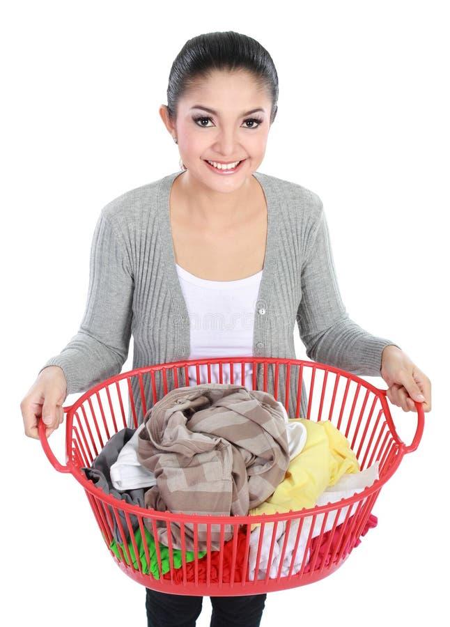Femme avec la blanchisserie photos stock