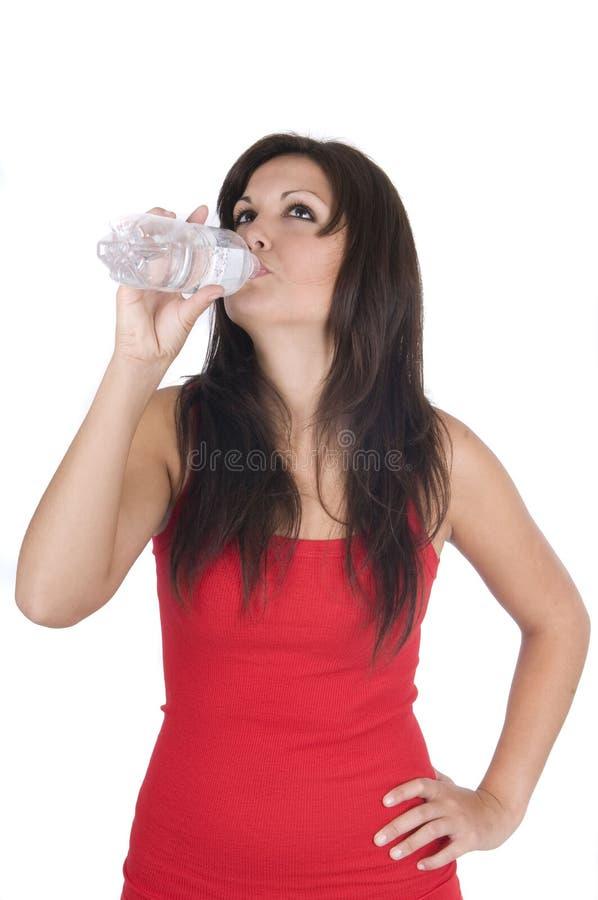 Femme avec la bouteille de l'eau minérale d'isolement image libre de droits
