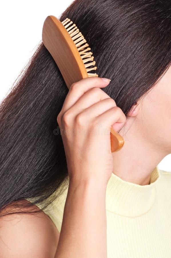 Femme avec la brosse à cheveux photos stock