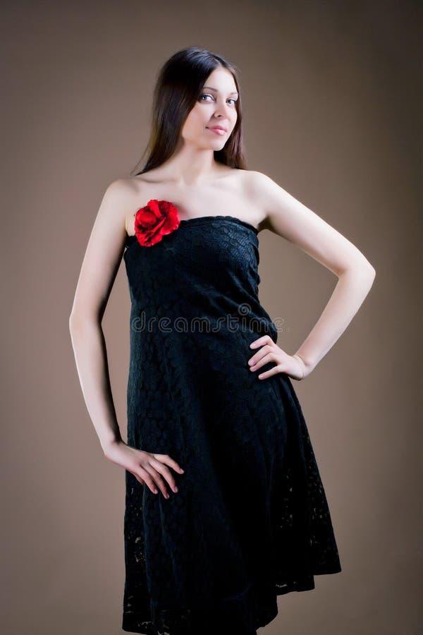 Femme avec la fleur photographie stock libre de droits