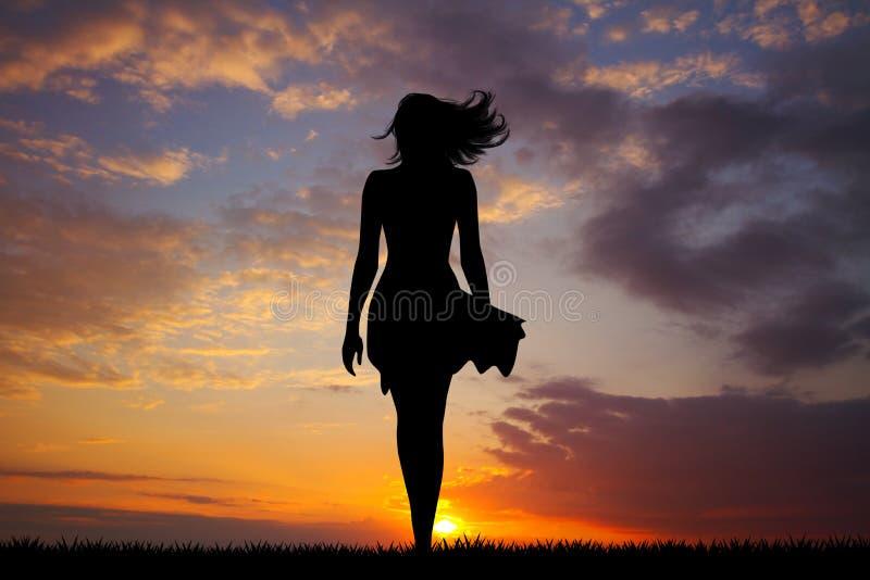 Femme avec la jupe et les cheveux dans le vent photos libres de droits