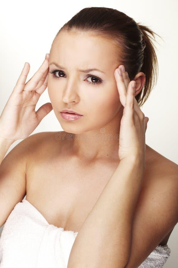 Femme avec la migraine photographie stock