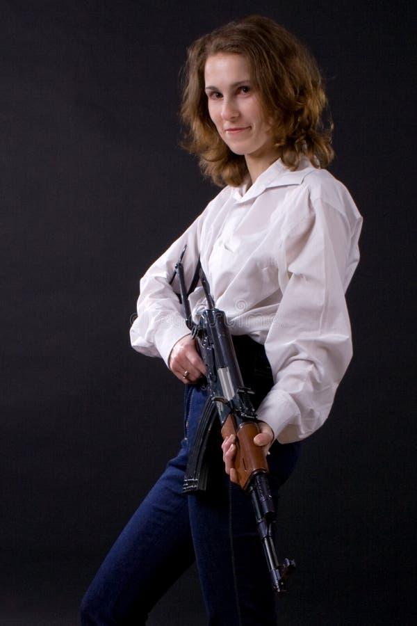 Femme avec la mitraillette photos stock