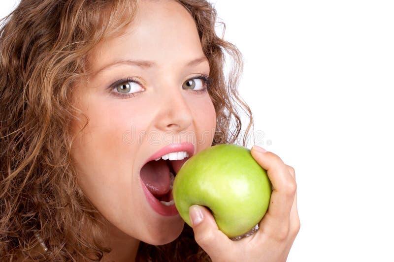 Femme avec la pomme photographie stock