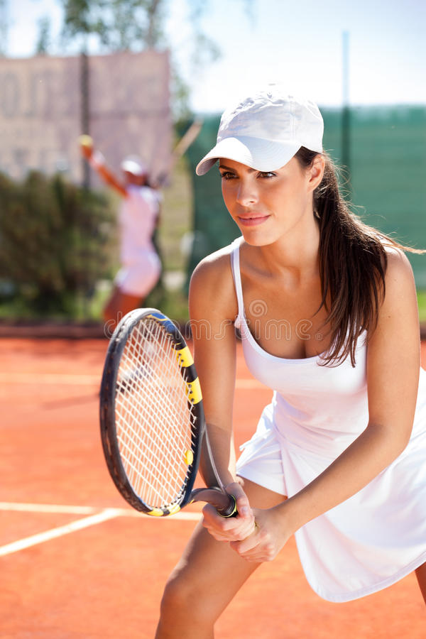 Femme avec la raquette de tennis photos libres de droits